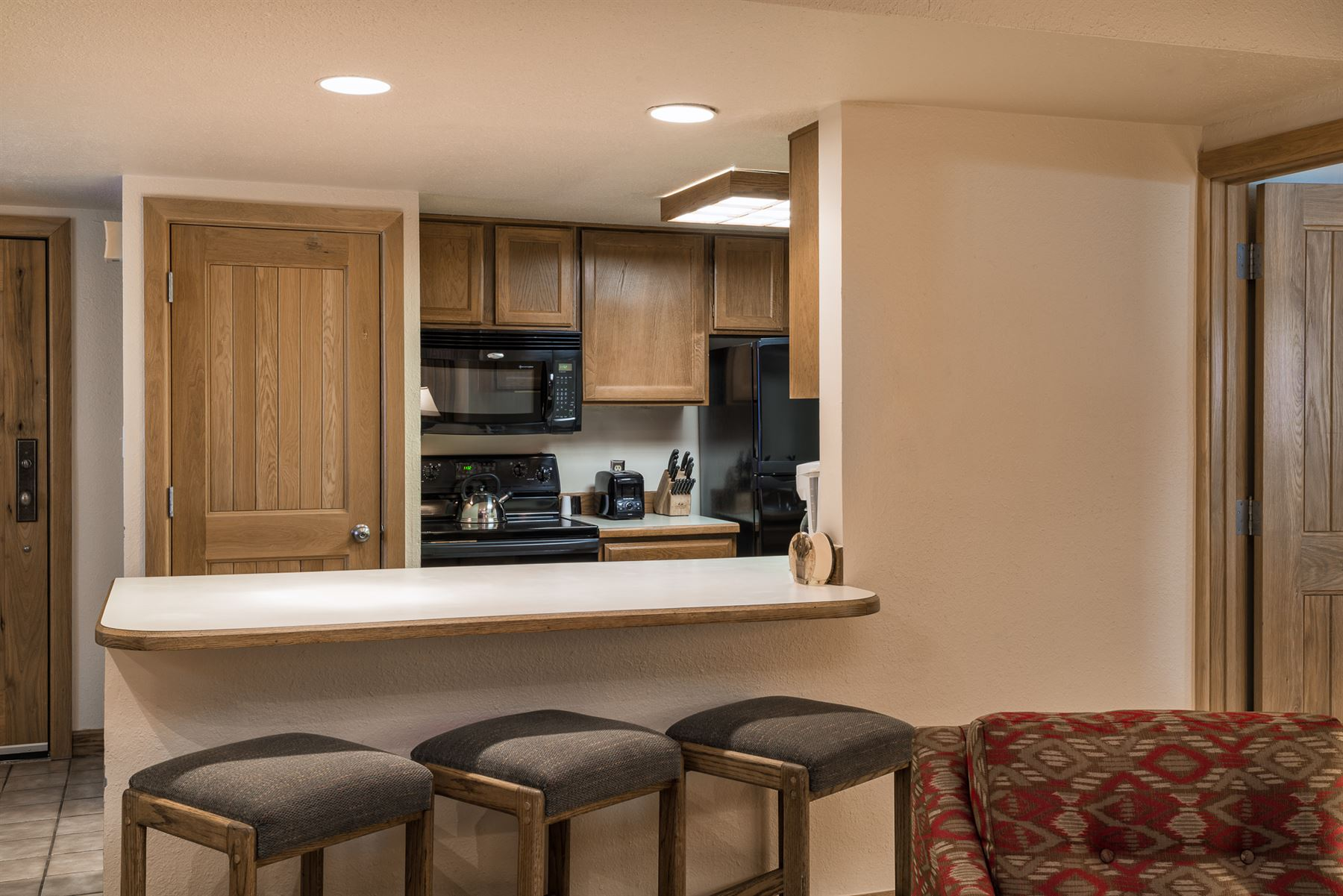 2BGold_View of kitchen with barstools