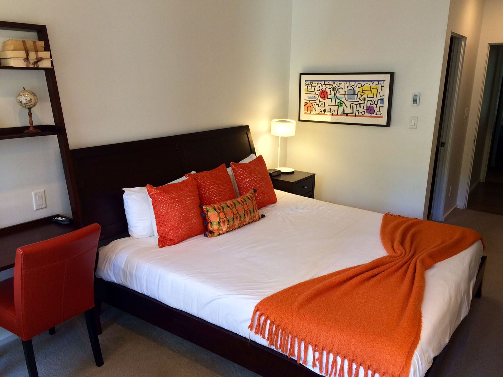 3BPlat_bedroom with king bed with decorative standing shelving next to it