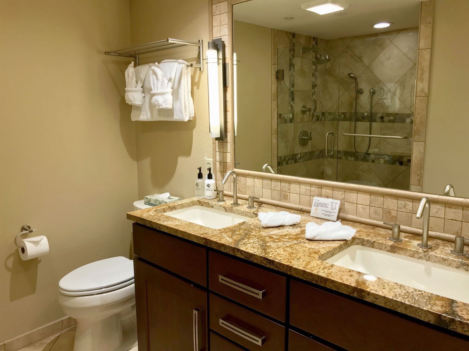 Bathroom with Dual sinks and stand up shower