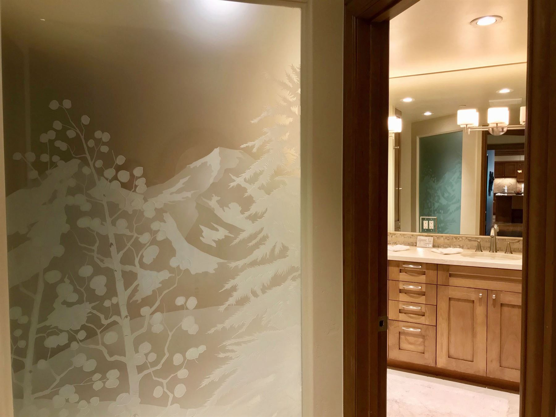 Frosted glass in the bathroom with a design of the alpine slopes