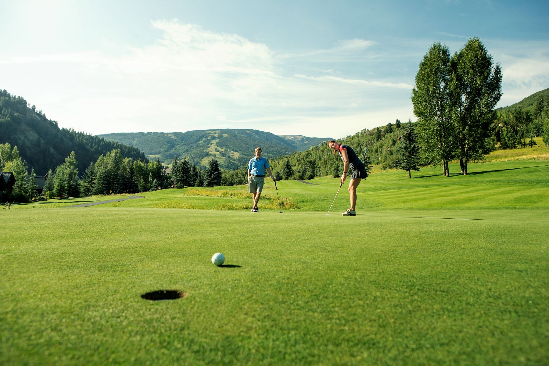 couple golfing in vail